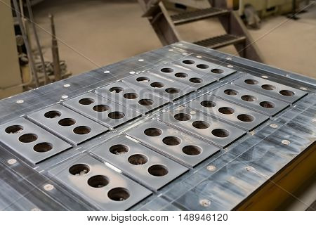 Brickyard. Metal molds for production of bricks, close-up