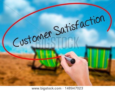 Man Hand Writing Customer Satisfaction With Black Marker On Visual Screen