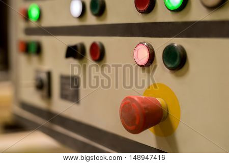 Image of red switch on remote control panel, close-up