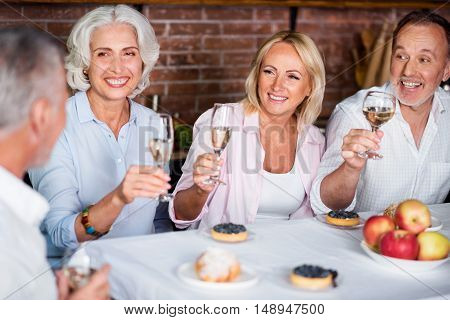 Party mood. Grown-up daughter visiting her parents at their house