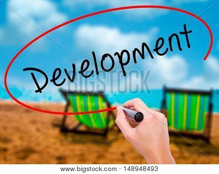 Man Hand Writing Development With Black Marker On Visual Screen