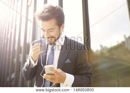 Businessman doing a positive phone call
