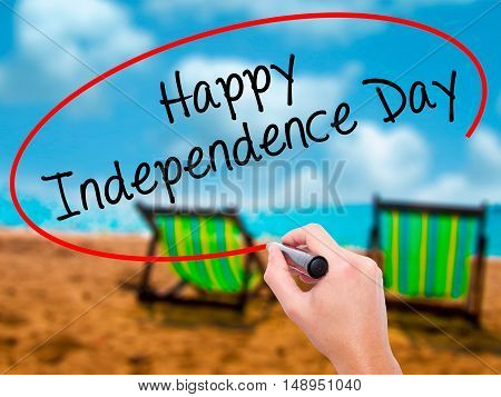 Man Hand Writing Happy Independence Day With Black Marker On Visual Screen