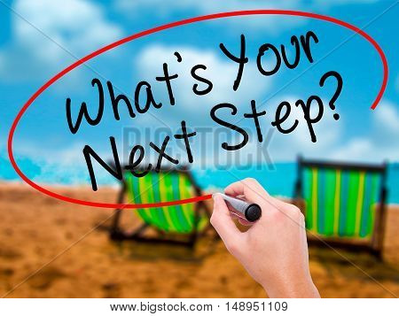 Man Hand Writing What's Your Next Step? With Black Marker On Visual Screen