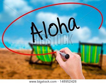 Man Hand Writing Aloha  With Black Marker On Visual Screen