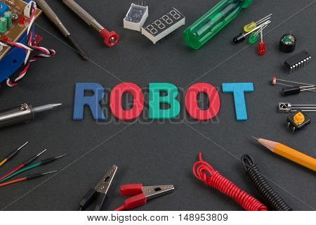 Close Up View Of Robot Kit Consisting Control Boards, Tools And Variety Of Sensor.