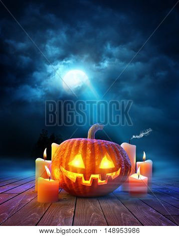 Halloween night Jack O Lantern pumpkin with glowing candles on a moonlit evening. 3D illustration.