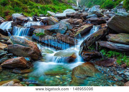 Cascade of tropical waterfall in Himalayas. Bhagsu, Himachal Pradesh, India. Polarizer filter used