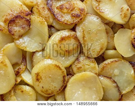 close up of rustic german bratkartofflen fried potatoes food background