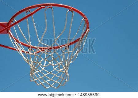Basketball hoop with blue sky background,basketball equipment.