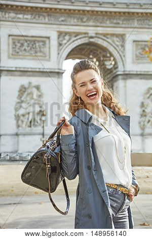 Smiling Young Fashion-monger In Trench Coat In Paris, France