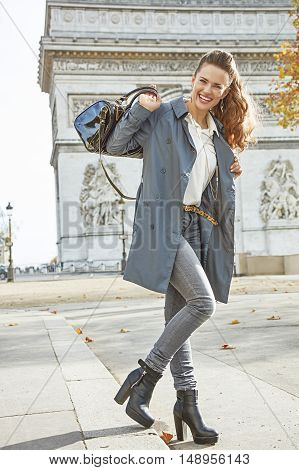 Happy Young Fashion-monger In Trench Coat In Paris, France