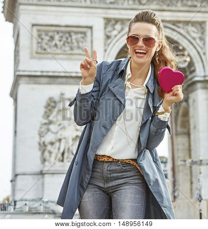 Happy Young Fashion-monger In Paris, France Showing Red Heart