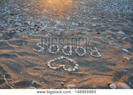 Sunset on Rhodes island in Greece. Stones on the beach