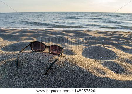 Shades laying down on beautiful sandy beach