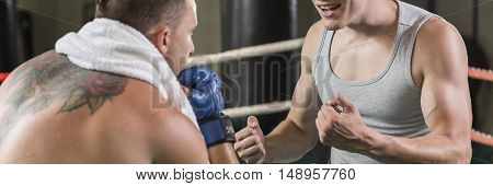 Coach encourages with engagement and commitment boxer to fight