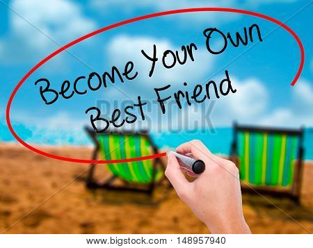 Man Hand Writing  Become Your Own Best Friend With Black Marker On Visual Screen