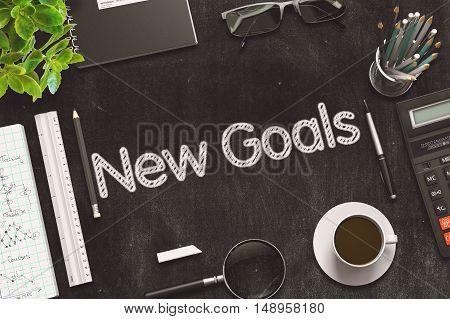 New Goals - Text on Black Chalkboard.3d Rendering. Toned Illustration.
