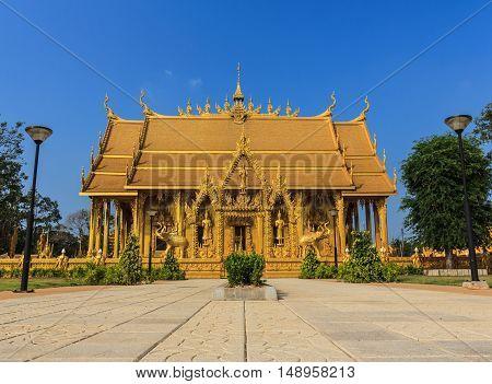Golden temple landmark Buddhist against blue sky in Chachoengsao Province Thailand.