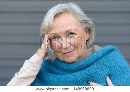 Elderly Elegant Woman With A Headache