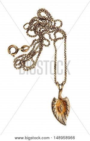 Golden leaf shaped pendant on a chain isolated over white