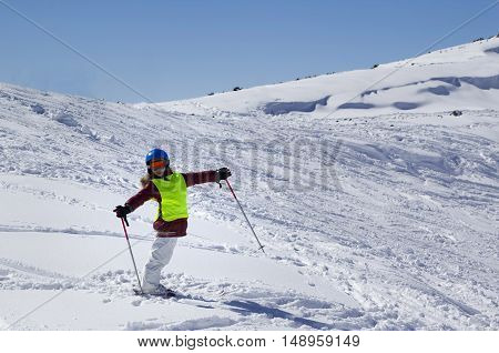 Little Skier On Ski Slope With New Fallen Snow At Sun Day