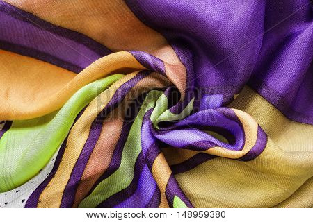 Colorful draped silk closeup as a background