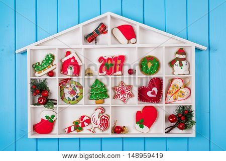 Christmas background with the gingerbread decorations and gift boxes.