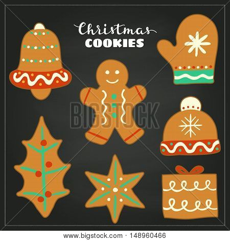 Doodle Christmas gingerbread cookies with icing isolated on the blackboard.