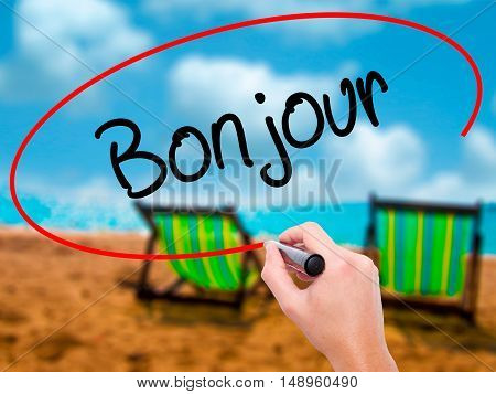 Man Hand Writing Bonjour  (good Morning In French) With Black Marker On Visual Screen