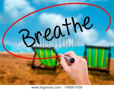 Man Hand Writing Breathe   With Black Marker On Visual Screen