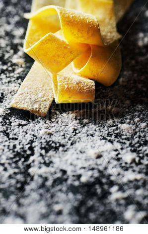 Flour And Pasta On A Black Background Close-up Vertical