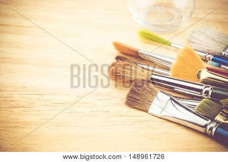 Vintage Filter, Group Of Watercolor Brush On Wood Table ,copy Space For Adding Your Content