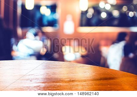 Empty Round Table Top At Coffee Shop Blurred Background With Bokeh Light,template Mock Up For Displa