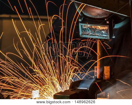 Welder and bright sparks. Construction and manufacturing