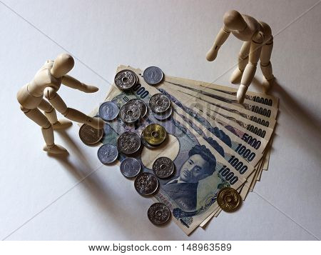 Mannequin and japanese currency figure model cash coin