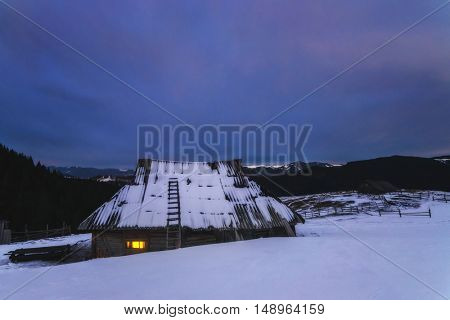 Fantastic landscape with snowy house. Carpathians, Ukraine, Europe.