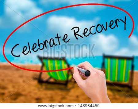 Man Hand Writing Celebrate Recovery With Black Marker On Visual Screen