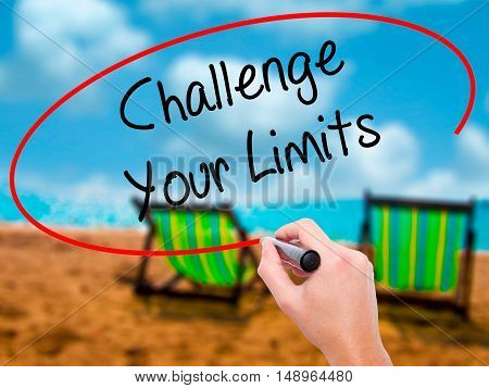 Man Hand Writing Challenge Your Limits With Black Marker On Visual Screen