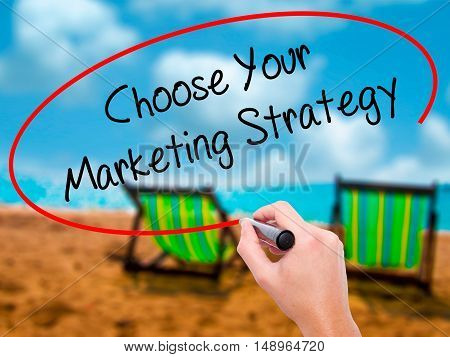Man Hand Writing Choose Your Marketing Strategy With Black Marker On Visual Screen