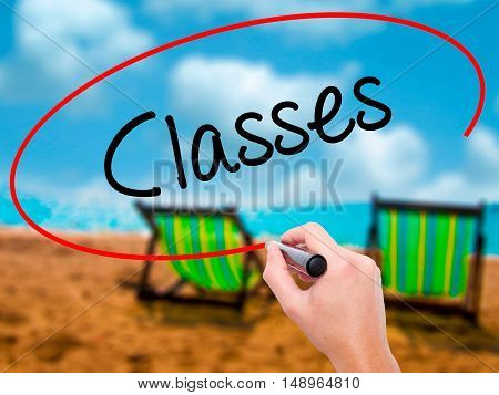 Man Hand Writing Classes   With Black Marker On Visual Screen