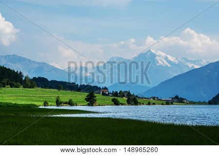 Beautiful view of the lake Muta (Haidersee) and Ortler peak, located near the village St. Valentin, Alps, Italy, Europe.
