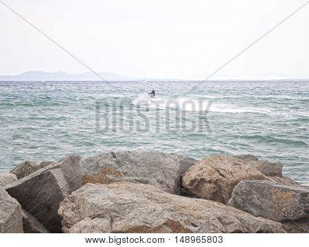 Jet Ski Moving Away The Coast, Jumping And Splashing