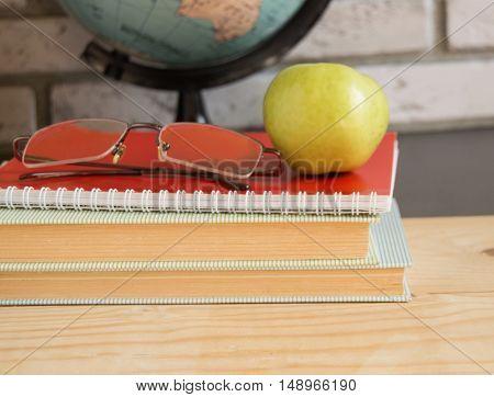 World teachers ' Day in school. Still life with books, globe, Apple glasses