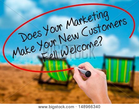 Man Hand Writing Does Your Marketing Make Your New Customers Fell Welcome?  With Black Marker On Vis