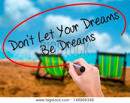 Man Hand Writing Don't Let Your Dreams Be Dreams With Black Marker On Visual Screen