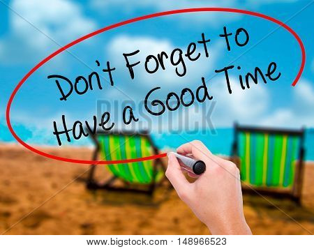 Man Hand Writing Don't Forget To Have A Good Time With Black Marker On Visual Screen