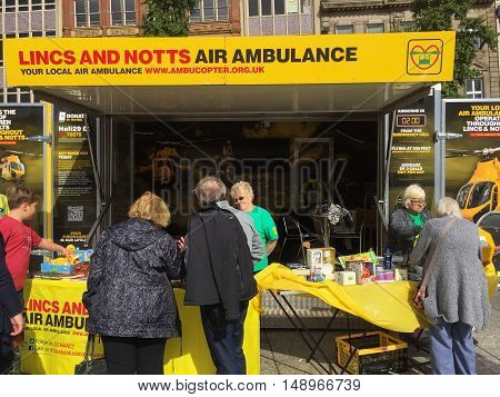 NOTTINGHAM ENGLAND - SEPTEMBER 24: Stall promoting Lincolnshire and Nottinghamshire Air Ambulance charity in Market Square Nottingham City Centre. In Nottingham England. On 24th September 2016.