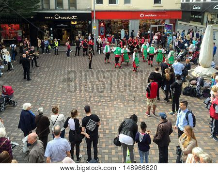 NOTTINGHAM ENGLAND - SEPTEMBER 24: Morris dancers performing Albert Street. In Nottingham England. On 24th September 2016.