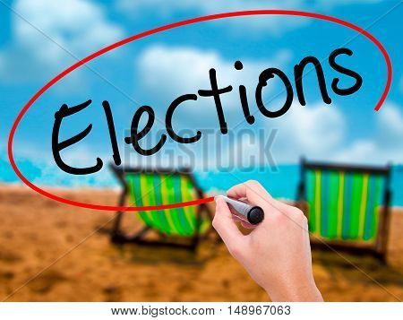 Man Hand Writing Elections With Black Marker On Visual Screen